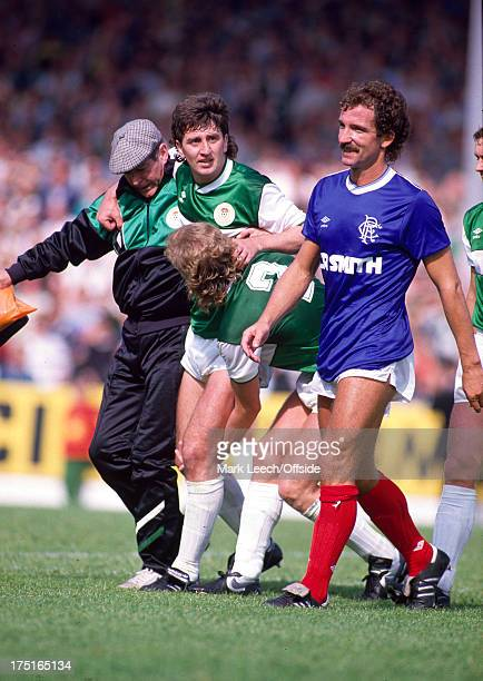09 August 1986 Scottish Premier League Football Hibernian v Rangers George McCluskey is helped off the pitch with a serious injury to his knee the...
