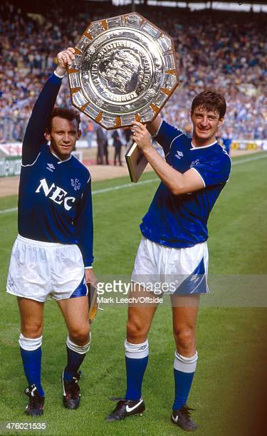 01 August 1987 Charity Shield Everton v Coventry City Peter Reid of Everton and teammate Wayne Clarke hold the Charity Shield after winning the match