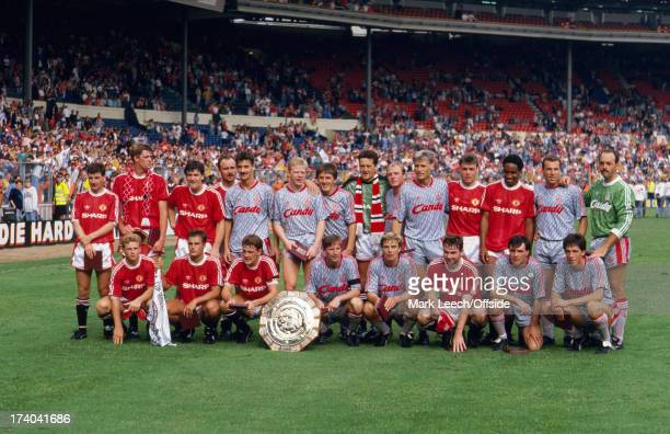 18 August 1990 FA Charity Shield Liverpool v Manchester United Players of both teams pose for a group photo as the Shield is shared after a draw