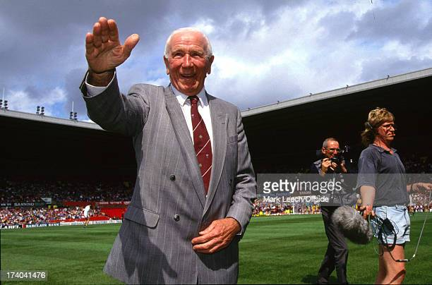 11 August 1991 Manchester United FC former manager Sir Matt Busby salutes the Old Trafford crowd at his testimonial match