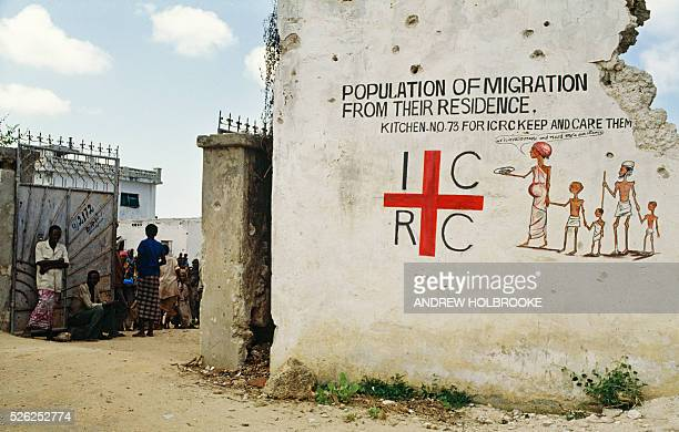 August 1992 A sign and drawing on a crumbling wall identifies an International Committee of the Red Cross feeding center in Mogadishu