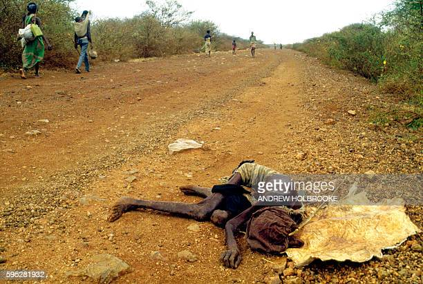 August 1992 - On the way to Baidoa, a starving woman, so weak from hunger that she could no longer walk, lies alone on the road, dying.