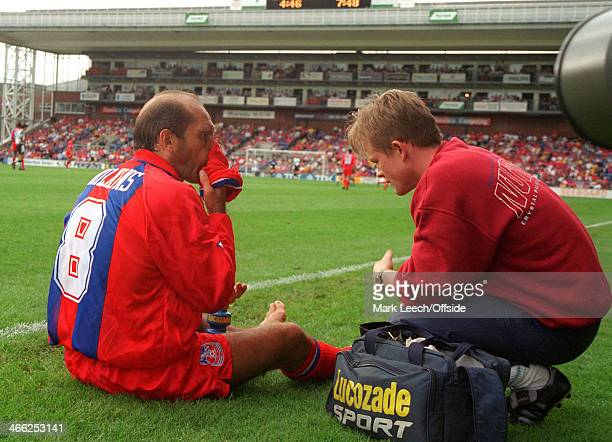 20 August 1994 FA Premiership Football Crystal Palace v Liverpool FC Ray Wilkins of Palace wipes his nose on a sock as he gets treated for an injury...