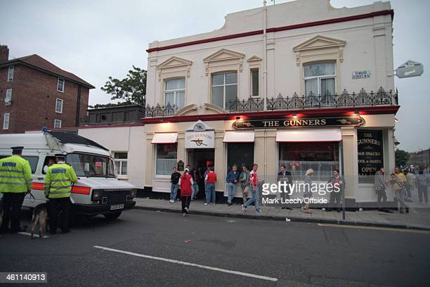 31 August 1994 Premiership Arsenal v Blackburn Rovers Arsenal fans stand outside the Gunners pub before the match with police surrounding the area