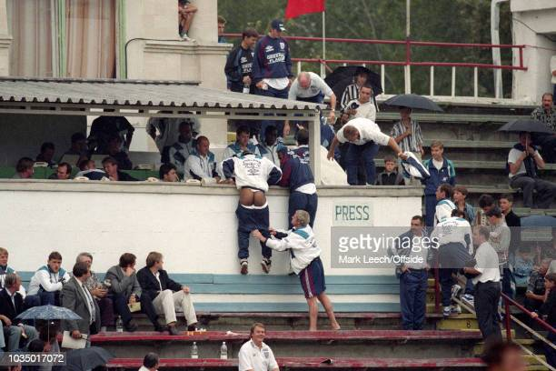 31 August 1996 Kishinev Under 21 International Football Moldova v England Paul Ince climbs for cover from the rain but has his pants pulled down by...