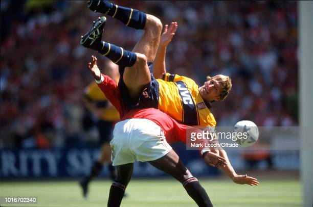 09 August 1998 FA Charity Shield Arsenal v Manchester United Tony Adams of Arsenal falls over the back of Andy Cole of United