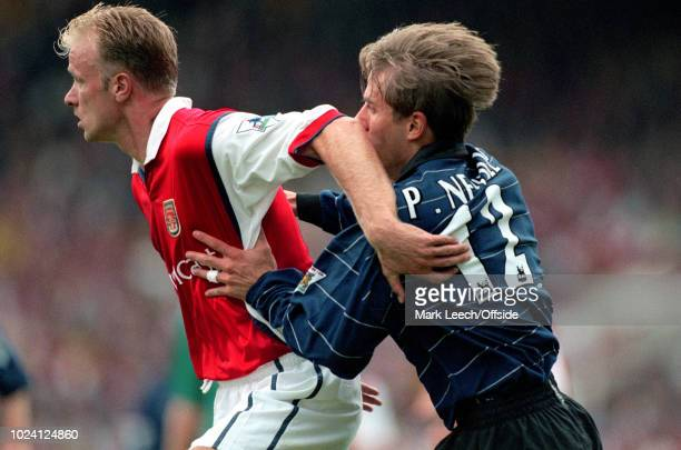 22 August 1999 Premiership Football Arsenal v Manchester United Dennis Bergkamp of Arsenal and Phil Neville of Manchester United