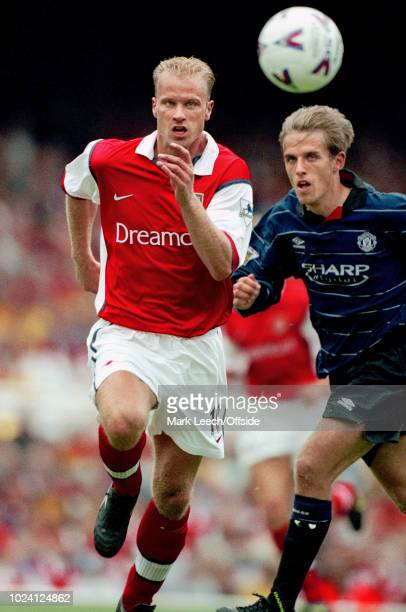 22 August 1999 Premiership Football Arsenal v Manchester United Dennis Bergkamp of Arsenal and Phil Neville of Manchester United race for the ball