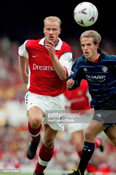 22 August 1999 Premiership Football Arsenal v Manchester United Dennis Bergkamp of Arsenal and Phil Neville of Manchester United race for the ball