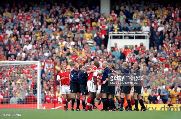 August 1999 - Premiership Football - Arsenal v Manchester United - Patrick Vieira of Arsenal and Jaap Stam of Manchester United are held back by...