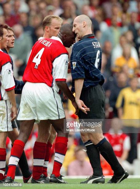 August 1999 - Premiership Football - Arsenal v Manchester United - Patrick Vieira of Arsenal and Jaap Stam of Manchester United clash heads as they...