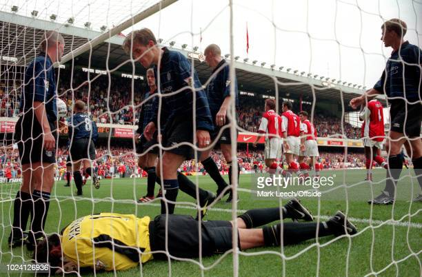 22 August 1999 Premiership Football Arsenal v Manchester United Roy Keane and Phil Neville of Manchester United stand over injured goalkeeper Raimond...