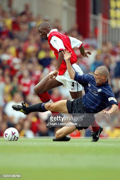 August 1999 - Premiership Football - Arsenal v Manchester United - Roy Keane of Manchester United stretches to tackle Patrick Vieira of Arsenal -