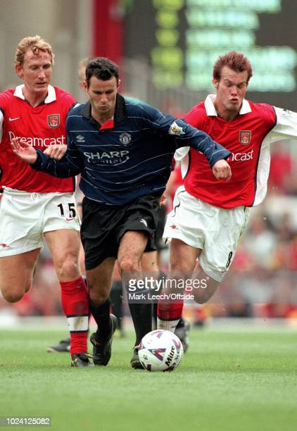 22 August 1999 Premiership Football Arsenal v Manchester United Ryan Giggs of Manchester United is flanked by Ray Parlour and Fredrik Ljungberg of...