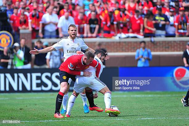 August 2 2014 Detroit MI Manchester United forward Wayne Rooney gets a hold on Real Madrid forward Isco as Real Madrid midfielder Xabi Alonso...