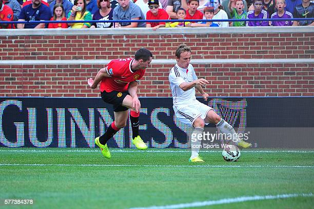 August 2, 2014 - Detroit, MI Real Madrid midfielder Luka Modric runs away from Manchester United defender Michael Keane during the match Saturday...