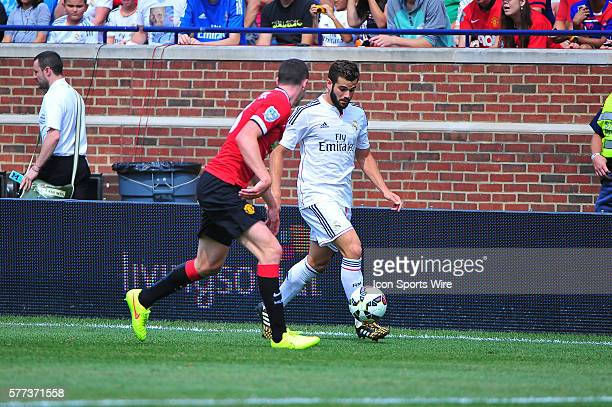 Manchester United defender Michael Keane marks Real Madrid forward Isco as he moves the ball downfield during the Real Madrid v Manchester United...