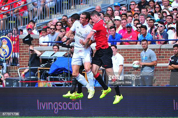 Real Madrid midfielder Gareth Bale and Manchester United defender Michael Keane go up for a header during the Real Madrid v Manchester United match...