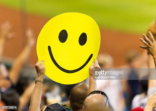 Houston Astros fans wave a smiley face banner during the MLB game between the Arizona Diamondbacks and Houston Astros at Minute Maid Park in Houston...