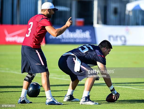 Houston Texans Quarterback Tom Savage prepares to take a snap from Houston Texans Center Greg Mancz during the Texans Training Camp at Houston...