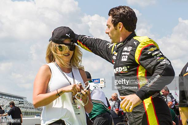 Simon Pagenaud with his girl friend Hailey McDermott on the grid getting ready for qualifying for the ABC Supply 500 at Pocono Raceway in Long Pond PA