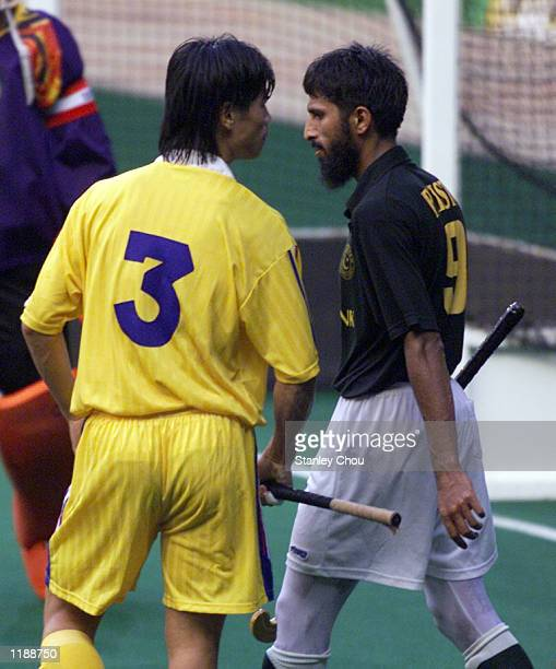 Chua Boon Huat of Malaysia confronted Tariq Imran of Pakistan at the match between Pakistan and Malaysia during the Sultan Azlan Shah Cup...
