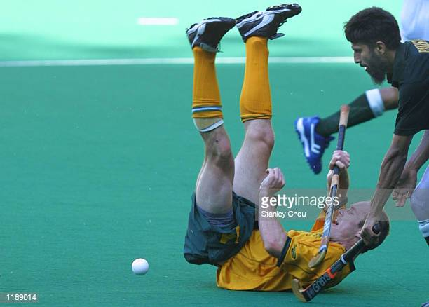 Daniel Sproule of Australia tuble after a challenge by Tariq Imran of Pakistan at a third placing playoff match during the Sultan Azlan Shah Cup...