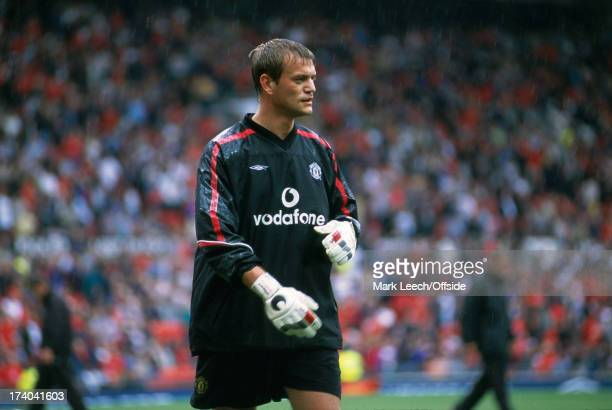 August 2001 Premiership Manchester United v Fulham United goalkeeper Roy Carroll warms up in the rain.