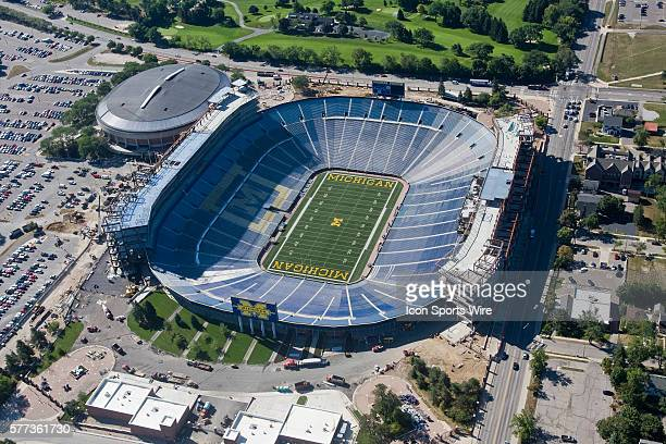 Aerial view of Michigan Stadium undergoing major renovations and expansion in Ann Arbor, MI. The three year, $226 million project will add 82 luxury...