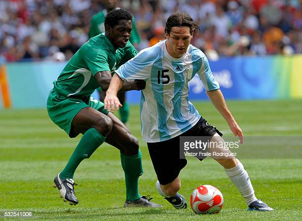 23 August 2008 Beijing China Lionel Messi of Argentina and Dele Adeleye of Nigeria fight for the ball during the men's soccer final at the National...