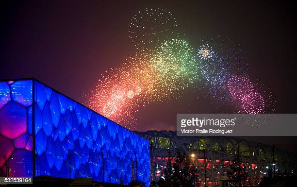 08 August 2008 Beijing Fireworks explode over National Stadium and National Aquatics Center also know as 'Water Cube' during the Opening Ceremony of...