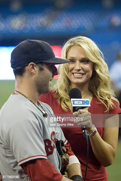 Dustin Pedroia is interviewed by NESN personality Heidi Watney after the game The Red Sox defeated the Blue Jays 84 in the game played at Rogers...