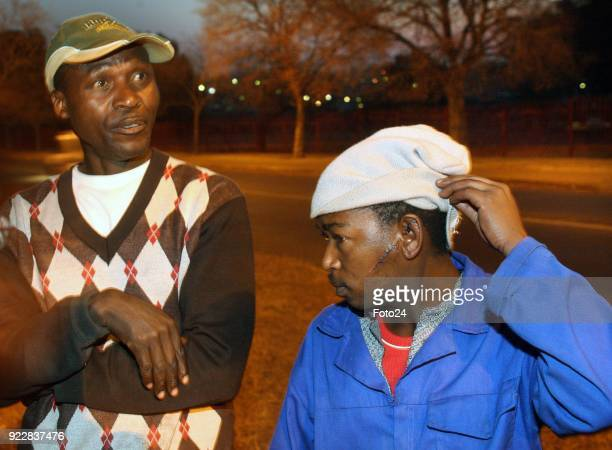 21 August 2008 South Africa Joseph Kodisang shows the wound on his cheek where Morne Harmse's sword cut him He got 16 stitches With him is Sam...