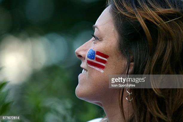 A Team USA fan watches as her team is introduced during Opening Ceremonies prior to tomorrow's opening round of the 2009 Solheim Cup to be played at...