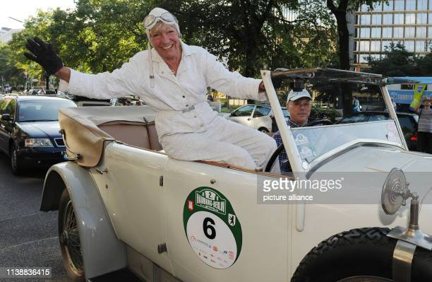 Heidi Hetzer manager of the Berlin car dealership Opel Hetzer and former rally driver sits on a Hispano Suiza H6 at the finish of the classic car...