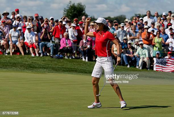 Michelle Wie celebrates after making a putt on the first hole during the singles competition on the final day of the Solheim Cup at the Rich Harvest...
