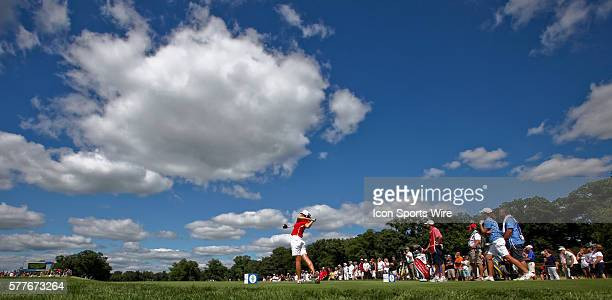 Michelle Wie tees off on the 18th hole during the singles competition on the final day of the Solheim Cup at the Rich Harvest Farms Golf Club on in...