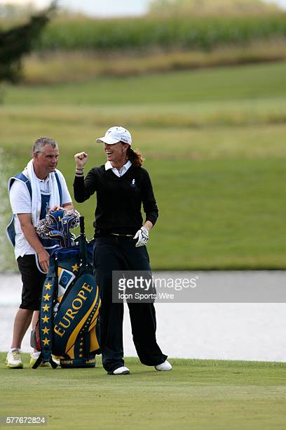 Sweden's Helen Alfredsson acknowledges a great shot by teammate Tania Elosegui during 1st day action at the 2009 Solheim Cup competitiont played at...