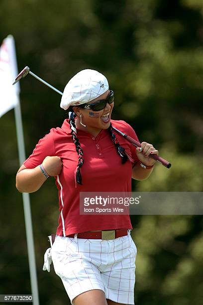 USA's Christina Kim flaps her arms after a Birdie on the 5th hole during Singles action on the final day at the 2009 Solheim Cup featuring the USA vs...