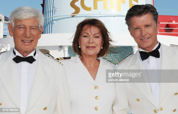 Actor Siegried Rauch actress Heide Keller and actor Nick Wilder smile onboard the cruiseship 'MS Deutschland' during an anniversary episode of their...