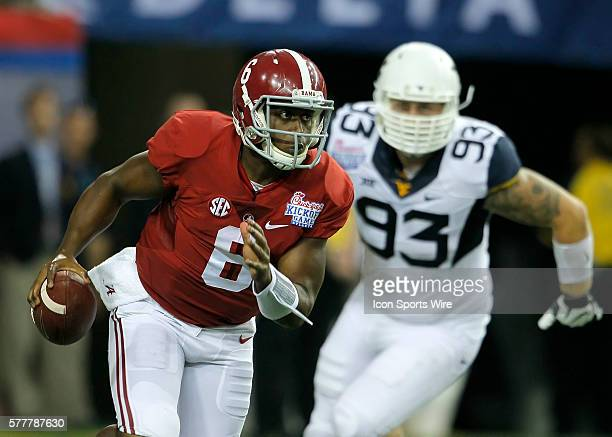 Alabama Crimson Tide quarterback Blake Sims rolls out in first half action of the West Virginia v Alabama game in the ChickFilA kickoff game at the...