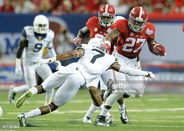 Alabama Crimson Tide running back Derrick Henry escapes a tackle by West Virginia Mountaineers cornerback Daryl Worley in first half action of the...