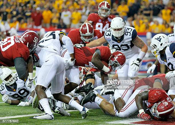 Alabama Crimson Tide running back TJ Yeldon dives in for a touchdown in first half action of the West Virginia v Alabama game in the ChickFilA...