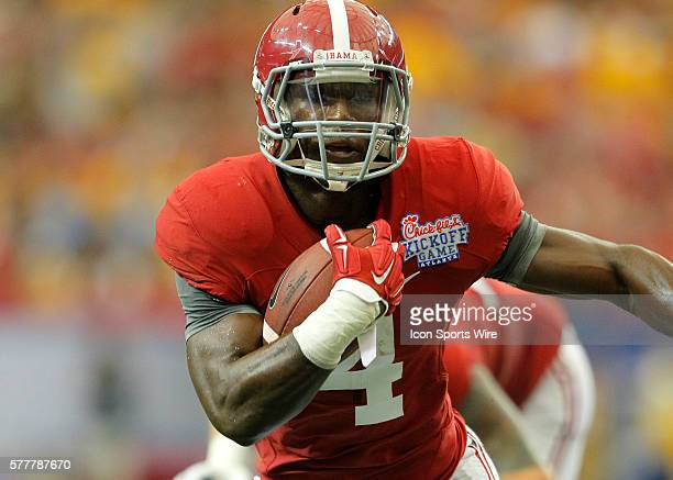 Alabama Crimson Tide running back TJ Yeldon rushes in for a touchdown in first half action of the West Virginia v Alabama game in the ChickFilA...