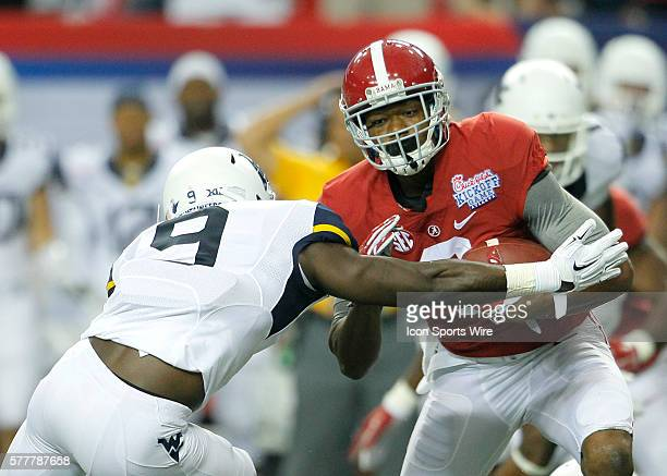 Alabama Crimson Tide wide receiver Amari Cooper is hit by West Virginia Mountaineers safety KJ Dillon in first half action of the West Virginia v...