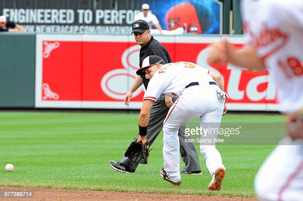 Baltimore Orioles second baseman Ryan Flaherty fields an infield ground ball against the Seattle Mariners at Orioles Park at Camden Yards in...