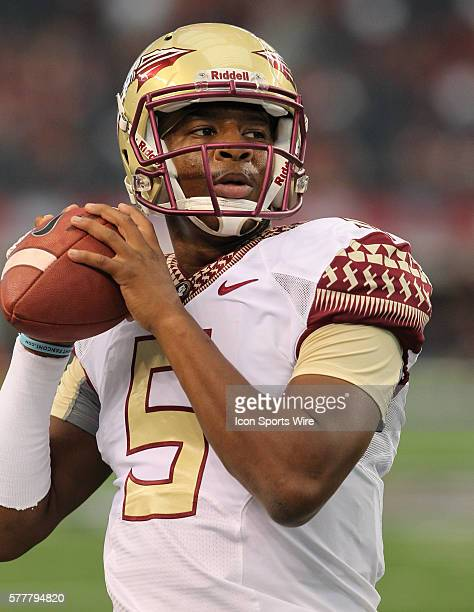 30 August 2014 Florida State Seminoles quarterback Jameis Winston warms up prior to the Advocare Cowboys Classic college football game between the...