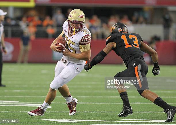 30 August 2014 Florida State Seminoles tight end Nick O'Leary runs up field as Oklahoma State Cowboys safety Jordan Sterns closes in during the...