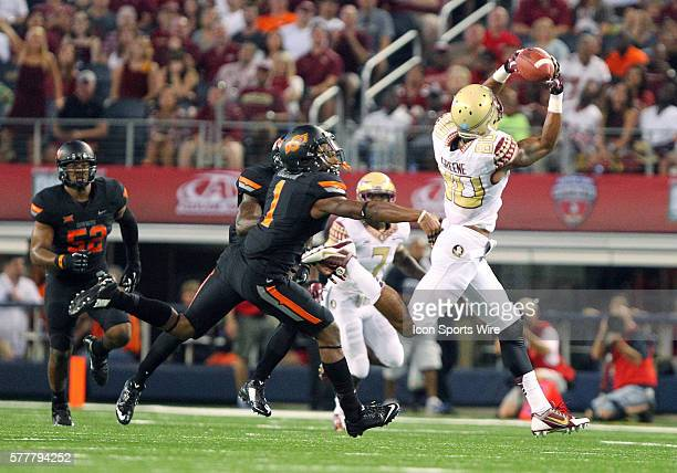 Florida State Seminoles wide receiver Rashad Greene catches the football past Oklahoma State Cowboys cornerback Kevin Peterson during the football...