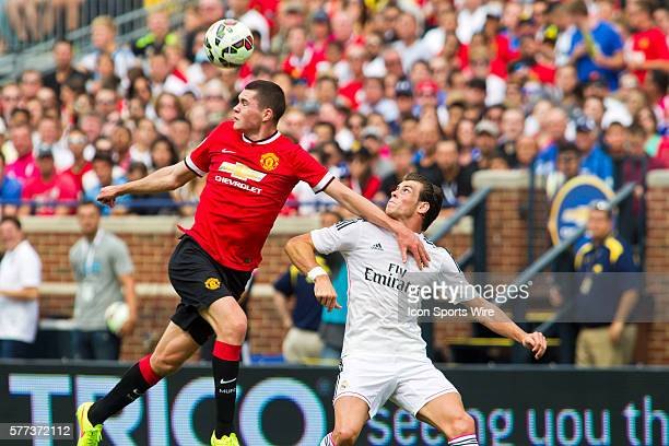 Manchester United defender Michael Keane, left, wins a header from Real Madrid forward Gareth Bale during a Guinness International Champions Cup...